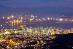 Rio de Janeiro downtown. Aerial view of Rio de Janeiro downtown by night. Rio-Niteroi Bridge spans Guanabara Bay royalty free stock images