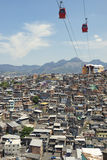 Rio de Janeiro Favela Slum with Red Cable Cars Royalty Free Stock Photography