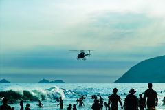 Ipanema's Beach, Rio de Janeiro, Brazil. RIO DE JANEIRO-FEB.10 ,2009: rescue helicopters patrols the bay of ipanema royalty free stock photo