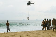 Ipanema's Beach, Rio de Janeiro, Brazil. RIO DE JANEIRO-FEB.10 ,2009: swimmers are rescued by the ice thanks to an helicopter due to the strong wave in front of royalty free stock photos