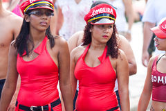RIO DE JANEIRO - FEBRUARY 11: Two girls in red dresses on free p Royalty Free Stock Photography