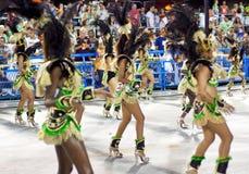 RIO DE JANEIRO - FEBRUARY 10: A womans in costume dancing on car Stock Photos