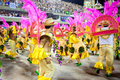 RIO DE JANEIRO - FEBRUARY 10: A womans and man in costume dancin. G and singing on carnival at Sambodromo in Rio de Janeiro February 10, 2013, Brazil. The Rio Royalty Free Stock Image