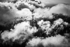 Rio de Janeiro helikopter flight. View on Christ the Redeemer in cloudy Rio de Janeiro from a helikopter Stock Photography