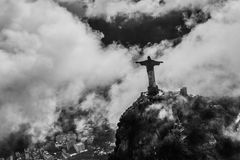 Rio de Janeiro helikopter flight. View on Christ the Redeemer in cloudy Rio de Janeiro from a helikopter Royalty Free Stock Photography