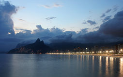 Rio de Janeiro, Ipanema Beach. Ipanema Beach at dusk,Two Brothers mountain in the background royalty free stock image