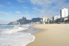 Rio de Janeiro Ipanema Beach Skyline Two Brothers Mountain Brazil. Rio de Janeiro Ipanema Beach Brazil with Two Brothers Dois Irmaos Mountain city skyline Royalty Free Stock Photo