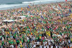 Flash Mob. Rio de Janeiro, July 28, 2013. Public of believers make flash mob during World Youth Day on the beach in Copacabana, Brazil royalty free stock images