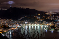 Rio de Janeiro at Night. View of Rio de Janeiro at Night from on top of Sugar Loaf Mountain with Christ the Redeemer Statue Lite up Stock Photo