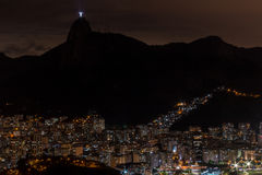 Rio de Janeiro at Night. View of Rio de Janeiro at Night from on top of Sugar Loaf Mountain with Christ the Redeemer Statue Lite up Royalty Free Stock Photography
