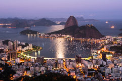 Rio de Janeiro, Sugarloaf Mountain by Sunset. Sugarloaf Mountain and Botafogo District view by Sunset in Rio de Janeiro, Brazil Stock Photo