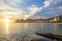 Rio de Janeiro sunset. Ipanema, Leblon and Arpoador beaches During seen the sunset of Rio de Janeiro with the hill Two Brothers and the Pedra da Gavea in the Royalty Free Stock Photos