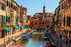 Rio del Magazen in Venice, a channel with pavements and street c. Afes royalty free stock photos