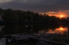 Rio do por do sol Fotografia de Stock