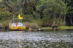 Woman paddling a boat in Rio Dulce  Guatemala Stock Image
