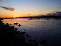 Rio e por do sol Imagem de Stock