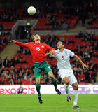 Rio Ferdinand against Vitali Rodionov. Rio Ferdinand (England) against Vitali Rodionov (Belarus) at 2010 FIFA World Cup Qualifiers match England - Belarus royalty free stock images