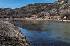 Rio Grande below Elephant Butte Dam. The Rio Grande just downstream from the Elephant Butte dam in southwestern New Mexico royalty free stock photography