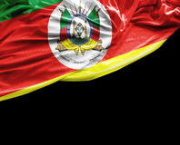 Rio Grande do Sul, Brazil waving flag on black background Stock Image