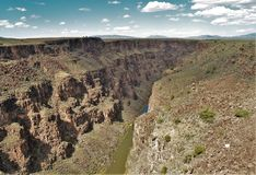 Rio Grande Gorge. The Rio Grande Gorge in northern New Mexico where the watercourse of the Rio Grande follows a tectonic chasm. At a depth of 800 feet, the gorge Royalty Free Stock Photo