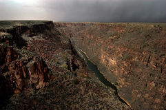 Rio Grande Gorge. Panoramic view of the Rio Grande Gorge photographed from the center of the Gorge Bridge over the river. A storm is approaching in the distance Stock Images