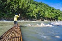 Rafting on bamboo raft on Rio Grande, Port Antonio, Jamaica royalty free stock photo