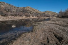 The Rio Grande northern view below the Dam in New Mexico. The Rio Grande as seen just below Elephant Butte Dam. The water level is very dry at this point mexico royalty free stock photos