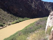 The Rio Grande River. In any other part of the country this body of water would be called a creek, but since in is a dividing line between two countries, it is Stock Photos