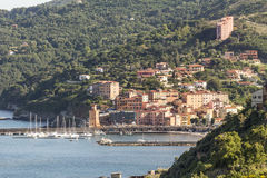 Rio Marina with harbor and watch-tower Torre dell'orologio, Elba, Tuscany, Italy. Europe stock photography