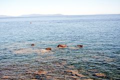 Rio Marina, panorama, horizon, Elba island, rocks and background. Rio Marina town, horizon, panoramic viw and bridge, Tyrrhenian sea, Italy, Livorno. Beautiful royalty free stock images