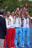 Rio2016 men double sculls winners. Men double sculls Croatian brothers and rowers Valent Sinkovic and Martin Sinkovic on a podium with gold medals next to bronze Stock Photos