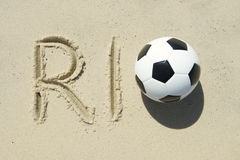 Rio Message with Football in Sand Stock Photography