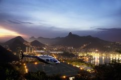 Rio at Night. Panoramic night view of Rio De Janeiro from sugar loaf mountain. With helicopter in flight Stock Photo