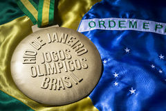 Rio 2016 Olympics Gold Medal on Brazil Flag Royalty Free Stock Photo