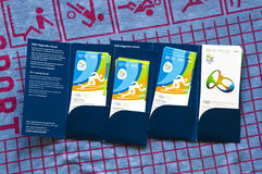 Rio 2016 Olympics tickets and folder. Folder full of Rio 2016 Olympics tickets on blue and red terry cloth towel Stock Images