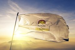 Rio San Juan Department of Nicaragua flag textile cloth fabric waving on the top sunrise mist fog. Beautiful royalty free stock photography