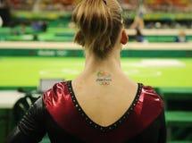 A Rio 2016 tattoo on Irina Sazonova of Iceland during the Artistic Gymnastics Women`s Qualification round at the Rio Olympic Arena. RIO DE JANEIRO, BRAZIL Stock Photo
