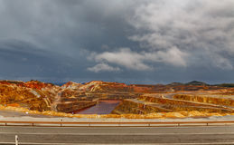Rio Tinto mine and road on stormy day, wide angle Royalty Free Stock Photo