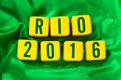 Rio 2016 written on yellow cube on green background Royalty Free Stock Photo