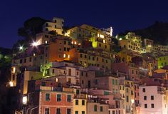 Riomaggiore buildings at night. Traditional gouses  in Riomaggiore, Cinque Terre, Italy Stock Photos