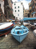 Riomaggiore   Cinque Terre Italy  old fishing boats on street wi Stock Photography