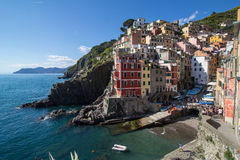 Riomaggiore, Cinque Terre, Liguria, Italy (May 4, 2014). View of colorful houses and the harbor in Riomaggiore, Cinque Terre, Liguria, Italy (May 4, 2014 Royalty Free Stock Image