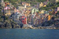 Riomaggiore,Cinque terre from the sea. Riomaggiore ancient village in Cinque Terre, Italy,from the sea...Very unique royalty free stock images