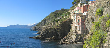 Riomaggiore cliffs. Over the blue sea - The Cinque Terre - Italia - Panorama Royalty Free Stock Photography