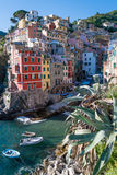 Riomaggiore, Italy. Legend says that houses are painted this way so that fishermen would be able to identify their house from the sea, to check whether their Royalty Free Stock Image