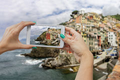 Riomaggiore photographing with mobile phone Royalty Free Stock Image