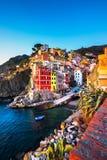 Riomaggiore town, cape and sea landscape at sunset. Cinque Terre, Liguria, Italy. Riomaggiore town, cape and sea landscape at sunset. Seascape in Cinque Terre royalty free stock image
