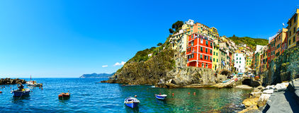 Riomaggiore village panorama, rocks, boats and sea. Cinque Terre Royalty Free Stock Images