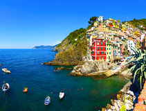 Riomaggiore village, rocks, boats and sea at sunset. Cinque Terr Royalty Free Stock Photo