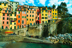 Riomaggiore village, rocks and old traditional houses. Cinque Te Royalty Free Stock Photos